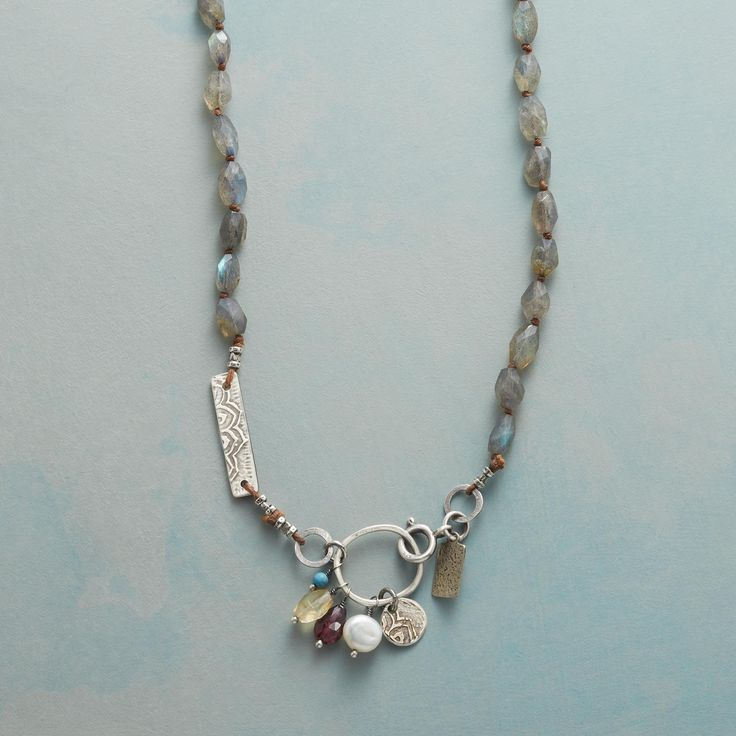"""STANZA NECKLACE--The shimmer of labradorite gives way to etched sterling silver charms, freshwater pearl, rhodolite garnet, citrine and turquoise in a long, lovely necklace with its own rhyme and rhythm. Sterling silver clasp. USA. Exclusive. 38""""L, 1"""" drop."""