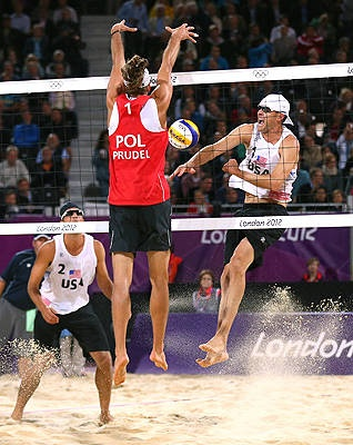 Mariusz Prudel of Poland blocks against Jacob Gibb of the United States during the teams' match