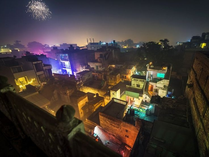 """Rooftops across the old city during Diwali. In Hinduism, the festival celebrates good triumphing over evil. This year, however, NPR reports that: """"To control the escalating pollution in Delhi, the Supreme Court has banned the sale of fireworks during this year's Diwali. (The use of fireworks, though, is not banned.)"""""""