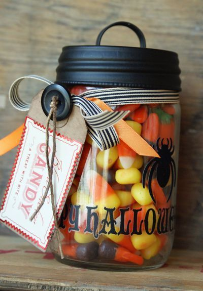 Cute Halloween Treat! Paint a mason jar, use stencils, stickers or decals & fill with candy.