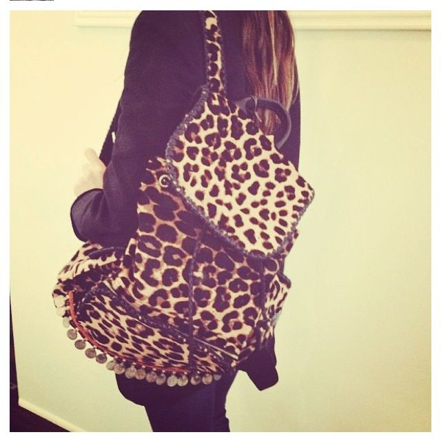 @Katherine Adams Power rocking our Leopard Backpack ! Available NOW for pre-order via SimoneCamille.com  Follow us on Instagram to stay posted on all things Simone Camille (@Simone Camille)