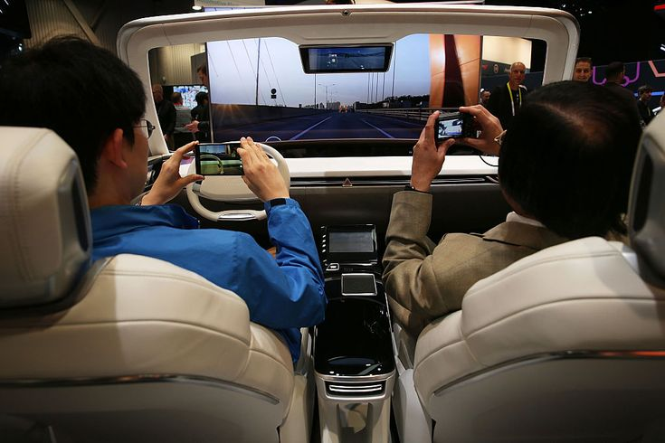 LAS VEGAS, NV - JANUARY 06: Show attendees experience autonomous driving mode in the Hyundai MOBIS 'i-Cockpit Car,' an experiential simulator of future car driving, at CES 2016 at the Las Vegas Convention Center on January 6, 2016 in Las Vegas, Nevada. CES, the world's largest annual consumer technology trade show, runs through January 9 and is expected to feature 3,600 exhibitors showing off their latest products and services to more than 150,000 attendees. (Photo by Alex Wong/Getty Images)
