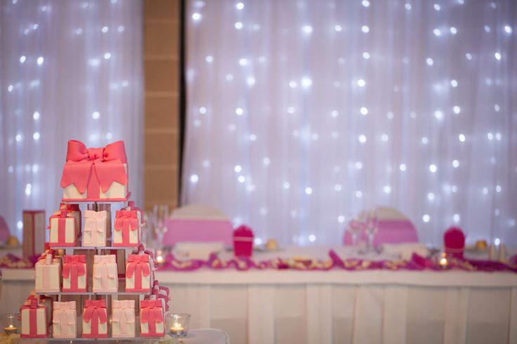 Our wedding cake by Crumbs Cake Art. Top cake chocolate mud, dark pink mini cakes chocolate mud, light pink mini cakes caramel mud. Photo by Saxon Cole Photography.