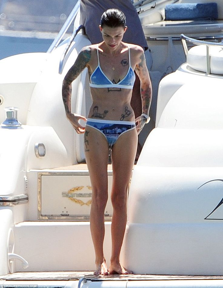 Svelte: Australian actress Ruby Rose shows off her body art collection in a blue bikini as she relaxes on a yacht off the coast of Ibiza