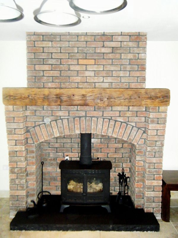 Brick around free standing cast iron fireplaces brick fireplace for stove fireplace - Brick fireplace surrounds ideas ...