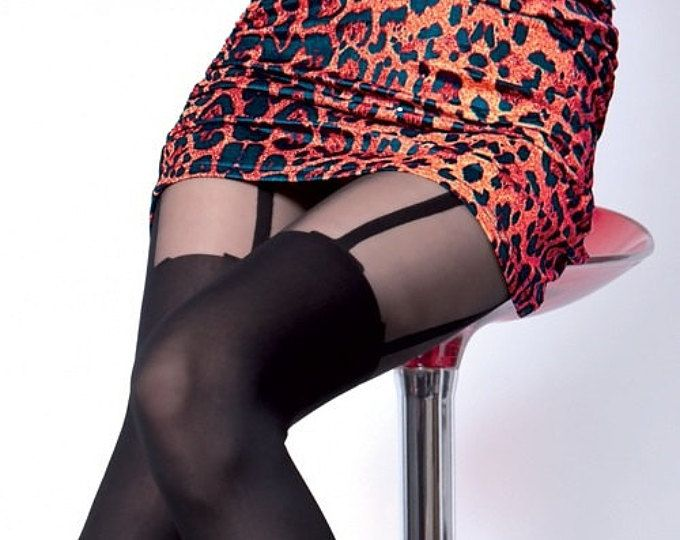 Elegant, sexy, soft and comfortable,highly fashionable patterned tights. Sexy tights with stockings imitation pattern. Patterned tights black color with the black color mock pattern.The leg is a heavier thickness and darker, The upper thigh area is sheer in this portion only.  color BLACK  high quality Here you buy size 4 - L  size chart - foto # 3  waiting time for delivery: Europe - 7 - 10 days US, Canada, Russia, Asia - 7 - 40 days (usually 10 - 21 days) Other countries - 7 - 40 days…