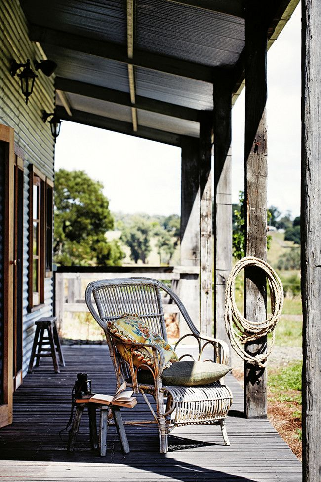 10 verandahs you'll want to relax on - A rustic setting is softened with neutral cushions to help while away the hours on this country verandah.