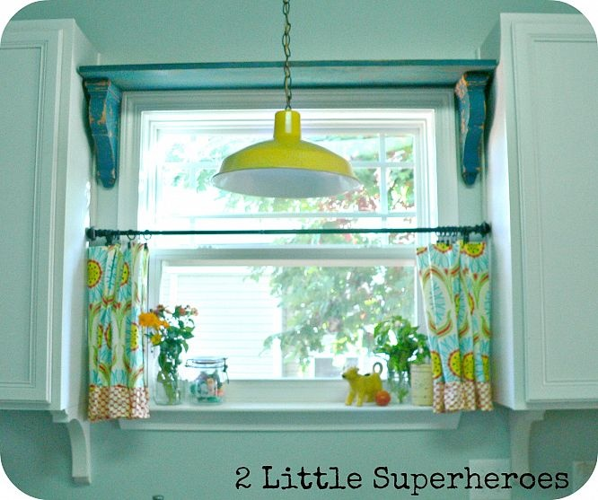 Lamp over the sink, kitchen curtains, shelf over window