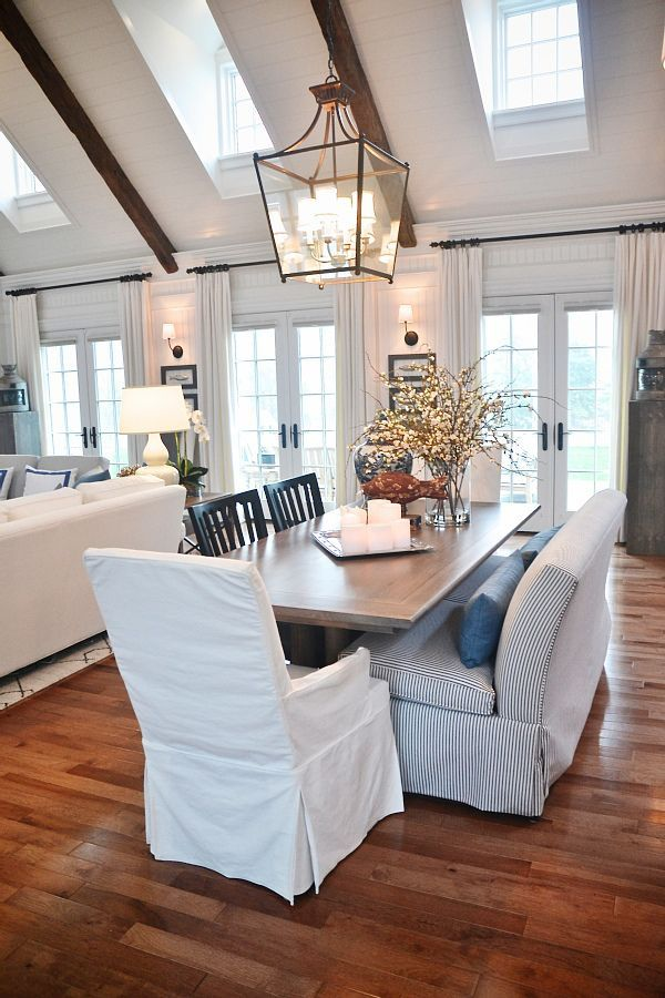 gorgeous neutral dining room/living room area. Love the open concept, high ceilings, lots of windows & doors, & the pops of blue.
