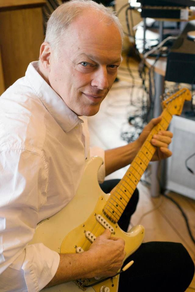 David Gilmour. Fender strat serial #000001, owned by Gilmour. The debate continues.