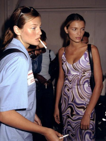 Models Bridget Hall and Esther Canadas get together backstage at designer Mark Eisen's spring/summer 1999 fashion show at the Chelsea Piers