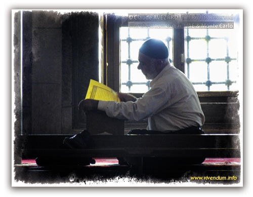 A corner of the Blue Mosque in Istanbul affords a degree of quiet for this Muslim to study his Qu'ran within the vast peace of this magnificent Masjid that mirror-squats on the other side of the ornamental park over which towers the ancient splendour of Aya Sophia's domes and minarets. © Claude Avézard, All Rights Reserved. stockphotomall.com