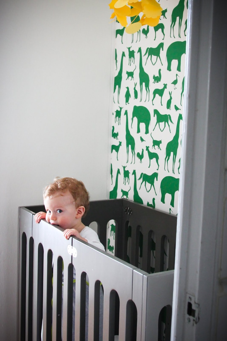 bold wallpaper for behind the crib in the nursey nook. love this idea, it could tie a color or theme together perfectly