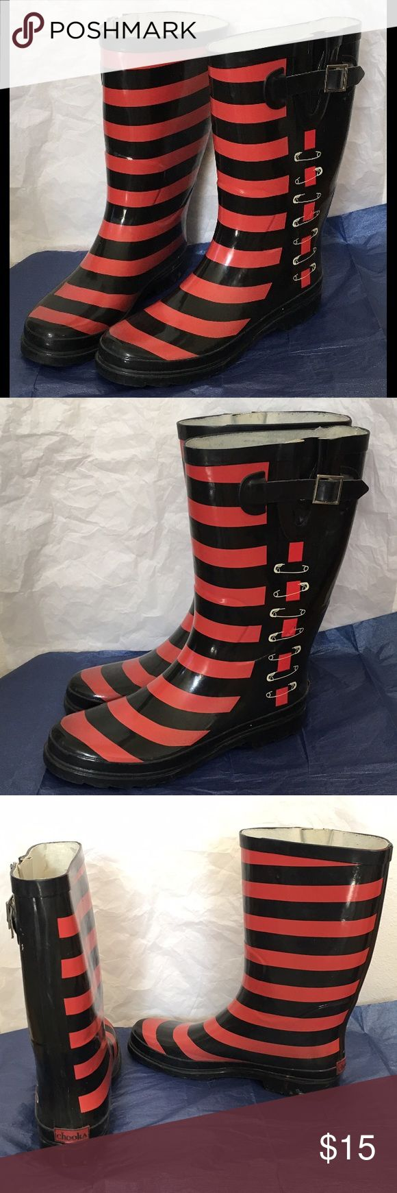 """Funky Safety Pin Striped Rain Boots Unique and well-worn pair of Chooka rain boots featuring a safety pin design on the outer calf and red on black stripes across the front and inner calf. Buckle closure with extension at the top to tuck in thicker pants. Without extension the top calf circumference is about 16"""". Flaws include several small puncture marks near the safety pins, minor discoloration inside the boot, needs inserts, and there is some dirt on the soles. Chooka Shoes Winter & Rain…"""