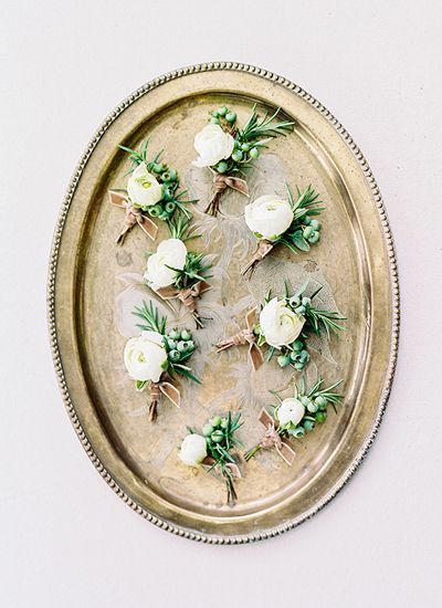 white boutonnieres   Callie Davis of Nancy Ray Photography