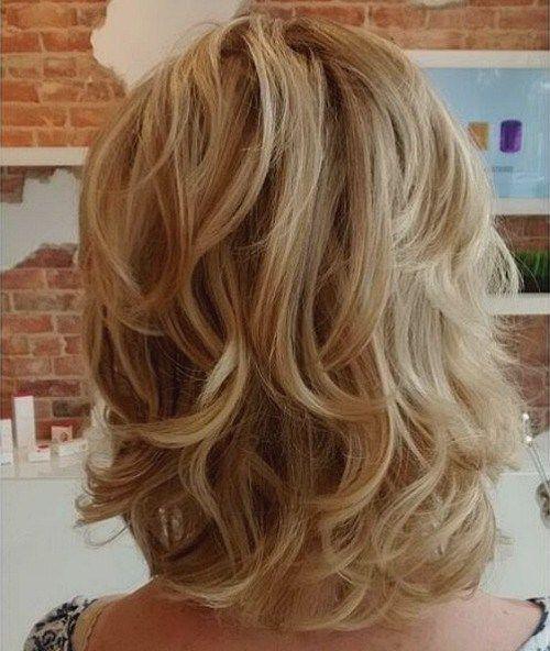 medium blonde layered hairstyle: