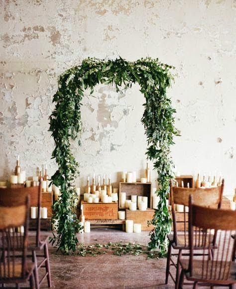 Industrial Warehouse Wedding Space - wedding ceremony foliage arch - candles