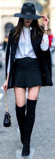 Barbora Ondrackova + winter style + black thigh high boots + white shirt + black mini skirt + sleeveless cape Cape: Missguided, Shirt: Zara, Skirt/Hat: Topshop, Boots: Stuart Weitzman, Bag: Chloé.