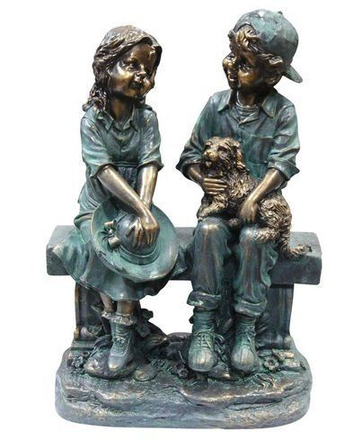 Girl And Boy Sitting On Bench With Puppy Statue Alpine
