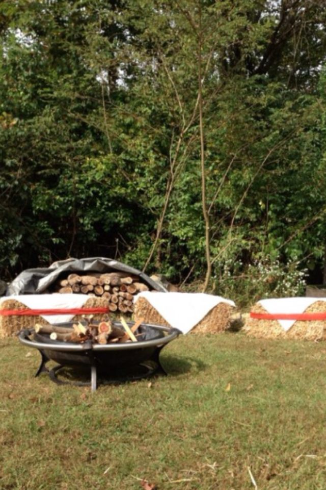 Fire pit with hay bales for seating.