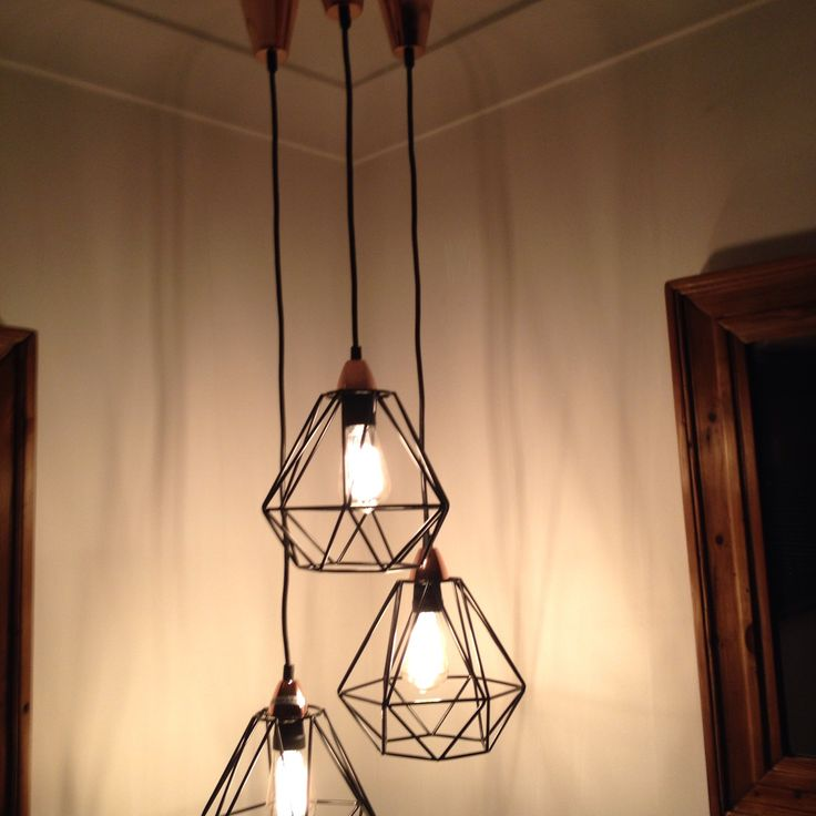 Love this grouping of these kmart geo pendant lights using the vintage look globes