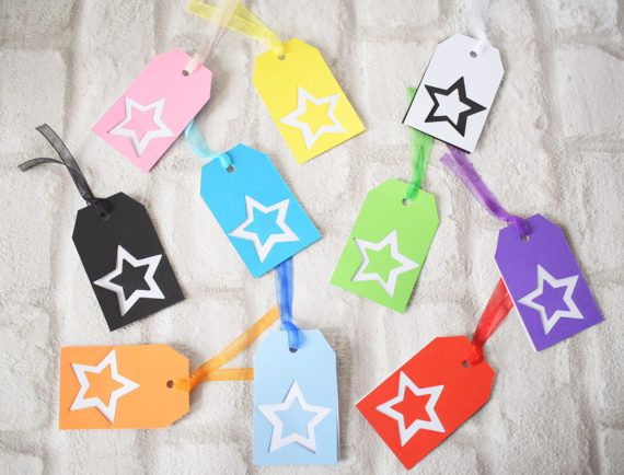 These gift tags feature a double layered star design, a matching coloured ribbon for easily attaching to gifts and come in a set of 5 in MIXED colours - all with the same design and a layer that has been left blank for a personal message.  The top layer is a coloured card that I cut a star shape from using a die cut - the actual star detail was removed leaving an outline in the card. From this star I cut a smaller version and then attached it onto a layer behind to make the design complete…