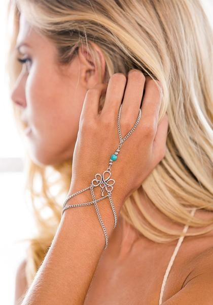 Add a boho vibe to any outfit by wearing this silver turquoise-beaded slave bracelet.