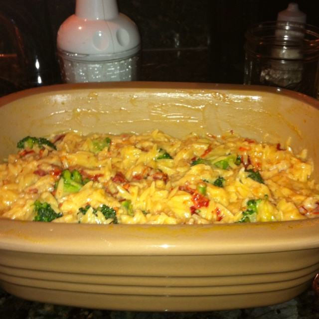 Creamy Broccoli and Sun Dried Tomato Orzotto. Made in 20min in The Pampered Chef Deep Covered Baker in my Microwave. This was sooo good!