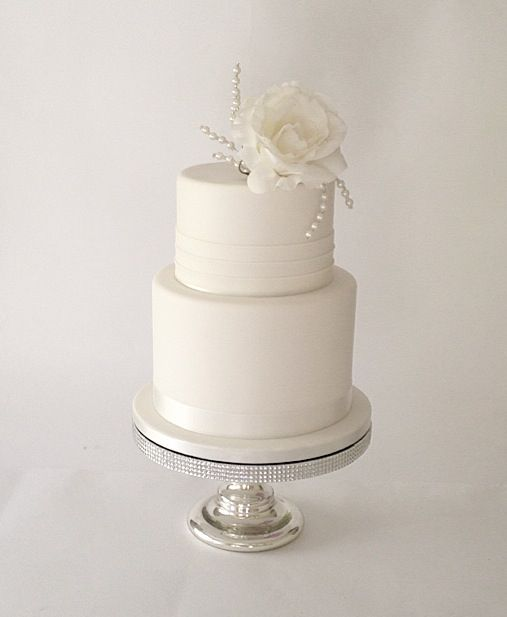 Clean and simple two tier white wedding cake.