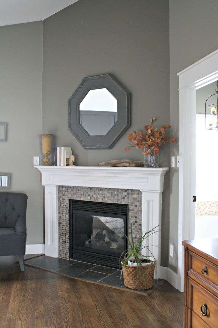 thrifty decor chick our home i like the fireplace hearth tile - Corner Fireplace Design Ideas