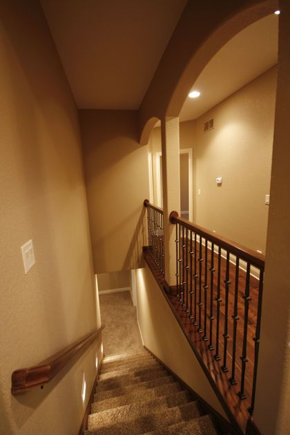 Open staircase to basement gives the space a more open feel.  Northview Custom Ranch by MJ Custom Homes (DSM)