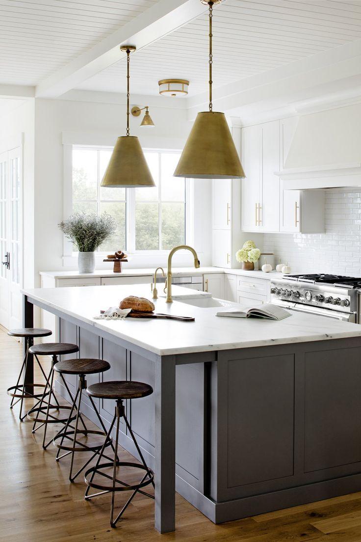 Brass Pendants Over The Kitchen Island Dark Gray Kitchen Island White Upper Cabinets Stephanie Ga Grey Kitchen Island Kitchen Ceiling Design Grey Kitchen
