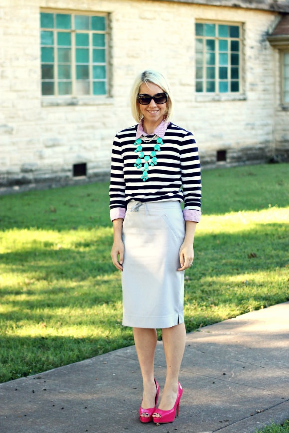 Striped sweater over dress shirt, neutral pencil skirt, pink heels, and aqua bubble necklace.