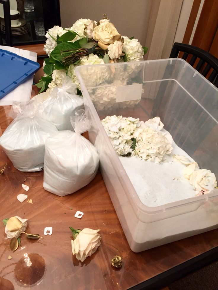 Use silica gel from michaels to preserve wedding bouquet looking alive and natural instead of hanging to dry or sending out for freeze dry
