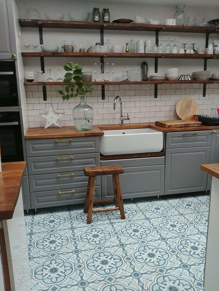 Ikea Bodbyn kitchen grey with white metro tiles, butler belfast sink, Moroccan cement tiles, reclaimed butcher block wood worktop and open shelves shelving.