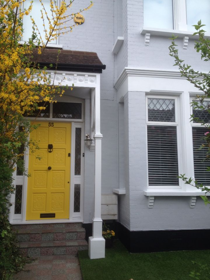Yellow from door + grey house exterior. Door 'Mister David' by Little Greene and brick paint 'Luna Grey' by Dulux