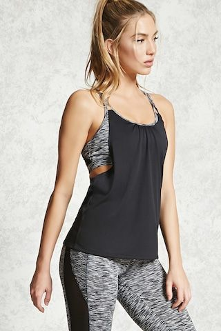 An athletic combo tank top featuring a marled knit built-in sports bra, dual straps, a scoop neck, and a draped back design.