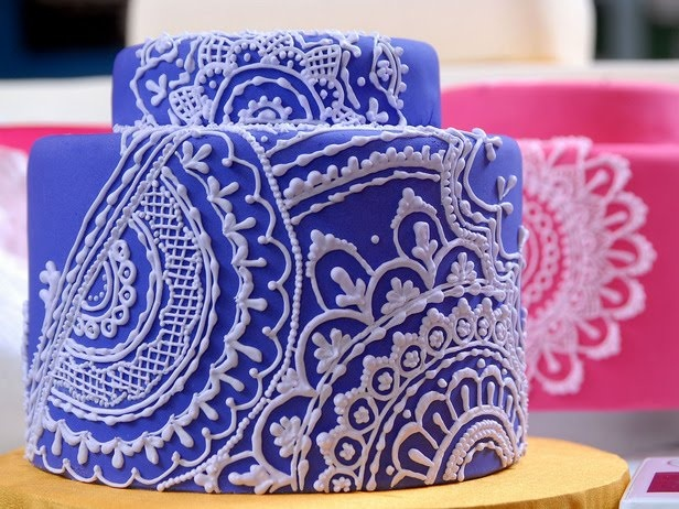 another pretty henna cake. Piping a little too thick for the design, but great idea. Trio of cakes?