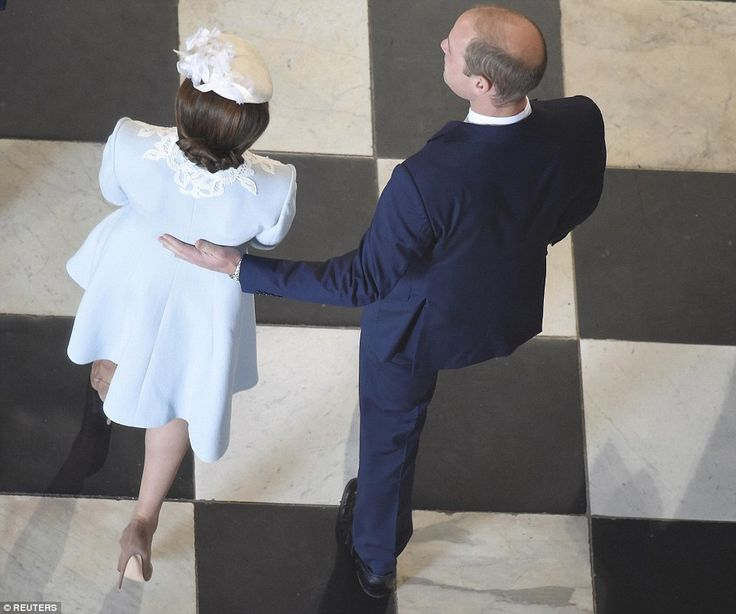 Prince WIlliam placed a supportive hand on his wife's back as they made their way through the cathedral