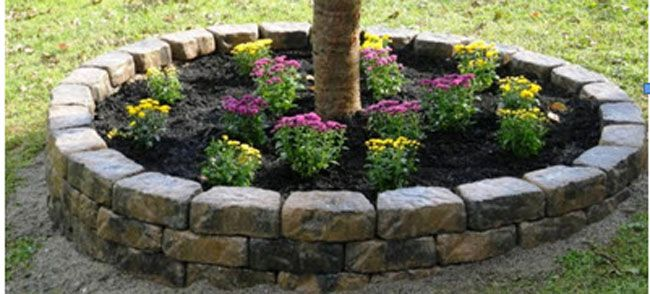 Create a raised flower bed using flagstone wall block to define spaces in your lawn or garden.
