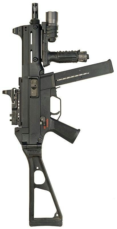 Heckler and Koch UMP 9mm sub machine gun with folding stock Speed up and simplify the pistol loading process  with the RAE Industries Magazine Loader. http://www.amazon.com/shops/raeind