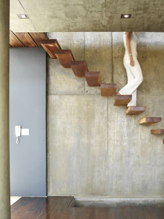 :: PROJECT Cliffhanger :: STAIRS :: Photo Credit: Louis Lemaire   adore the exposed concrete wall, the wood treads, the full height steel door, lovely detail #projectcliffanger #stairs