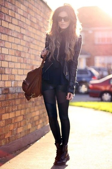leather jacket, sheer and opaque tights, shorts, combat boots.