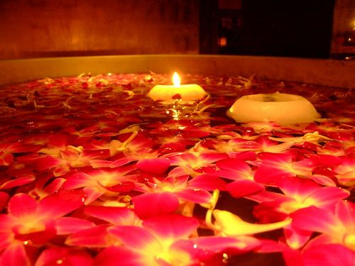 Candles And Flowers In Water Great To Add To A Hotel