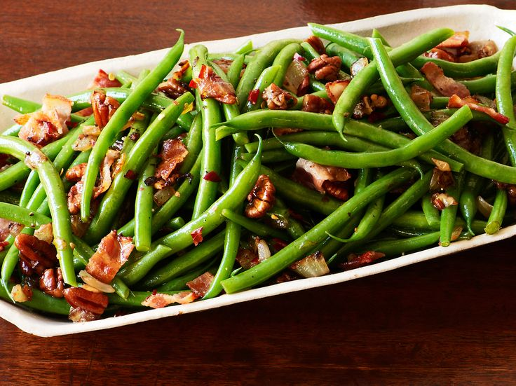 Green Beans and Bacon from FoodNetwork.com *I just sauteed lots of onion in bacon drippings, added crushed garlic, tossed in the cooked green beans, a splash of lemon and plenty of red pepper flakes. we love it!!!