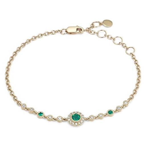 Inspired by vintage jewelry, this sophisticated 14k yellow gold bracelet features a milgrain halo with pavé-set diamonds that frame a beautiful round-cut emerald. This piece will be treasured for years to come.