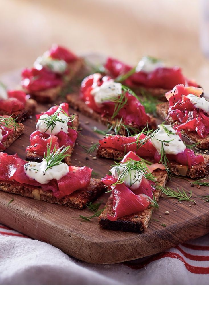 These colourful canapés are perfect for serving at your next party. The smoked salmon takes on a beautiful pink colour thanks to the beetroot, while a horseradish, caper and lemon cream adds indulgence. Serve on rye bread for a super simple Christmas snack.