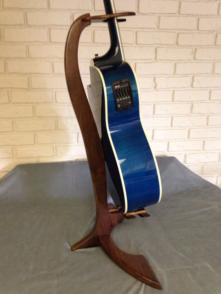 A personal favorite from my Etsy shop https://www.etsy.com/listing/235833899/walnut-guitar-stand