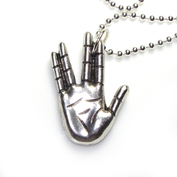 Star Trek Vulcan hand sign (Etsy:: http://www.etsy.com/listing/86273317/star-trek-vulcan-hand-sign-live-long-and )