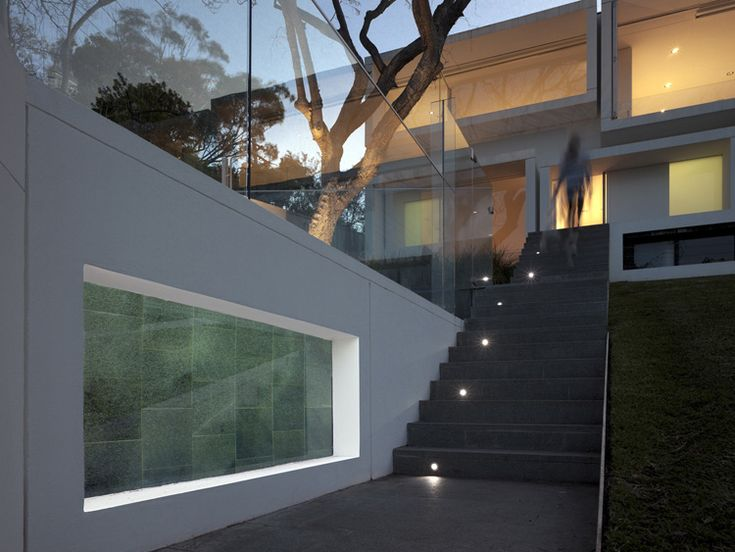 The project is a substantial renovation of a 1930's cottage into a contemporary home for a young family. The re-modelling includes the addition of a new upper floor as well as major landscape works including a pool. The extensively glazed facade is protected by a series of projecting prefabricated sunshades, expressed as an abstract cluster of picture frames which serve a variety of functions including the framing of views, reduction of solar gain, privacy screening and the creation of an…